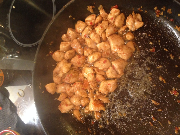 Chicken frying in spices